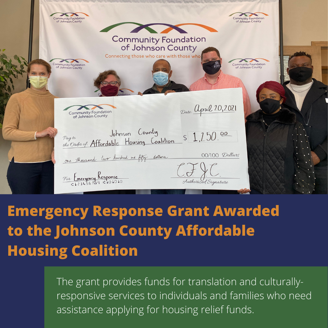 Six people holding a large check awarded to the Johnson County Affordable Housing Coalition